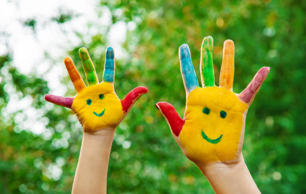 two hands with smiling faces