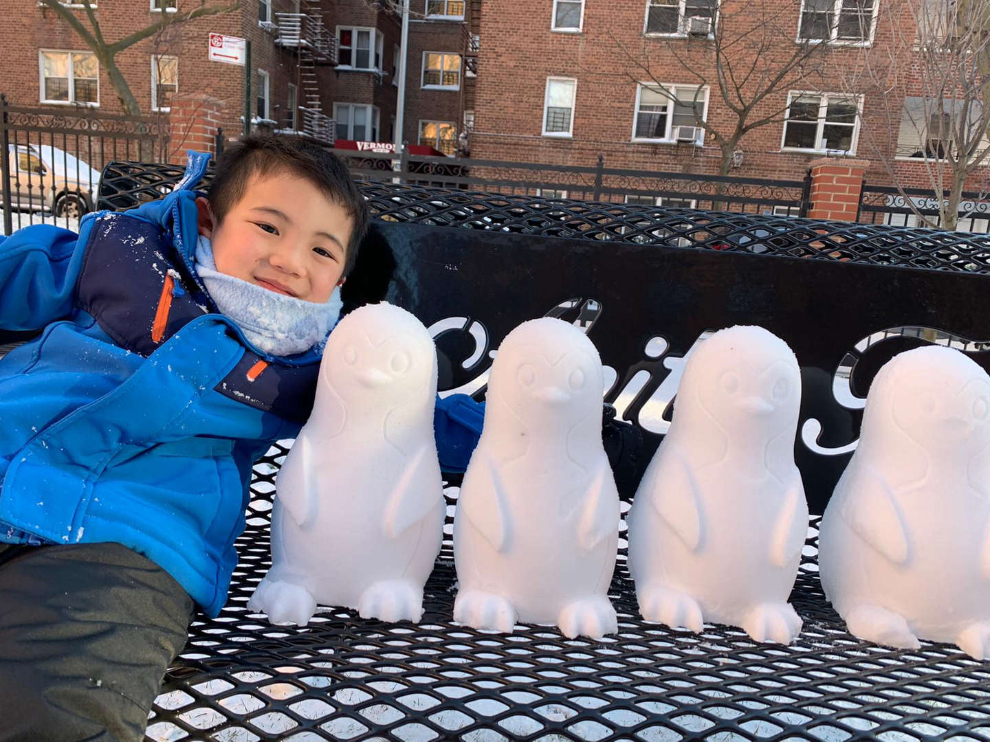 a boy with four little snow figures