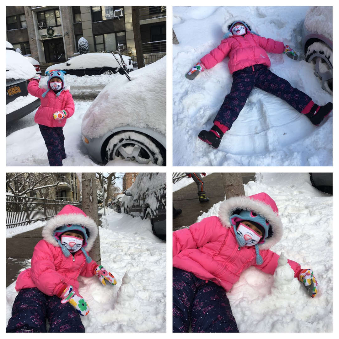 a girl in pink next to a car, making a snow angel and playing in the snow