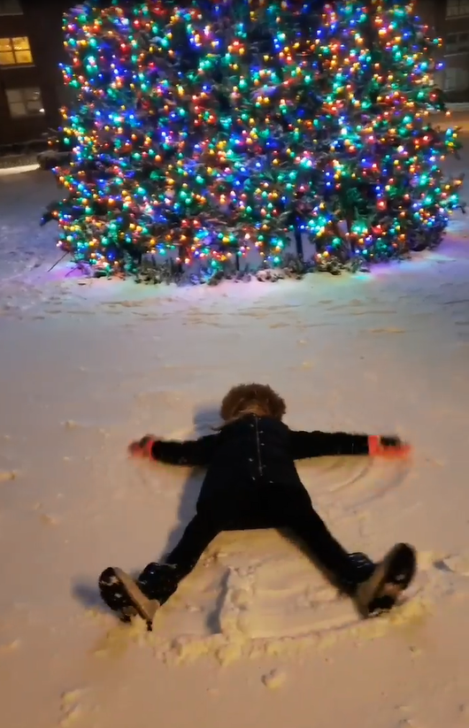 snow angel in front of the tree