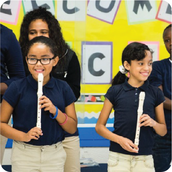 Students playing music together. Courtesy Save The Music.