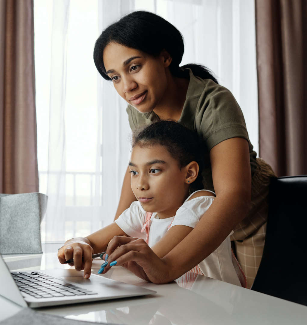 Mother helping child with remote learning