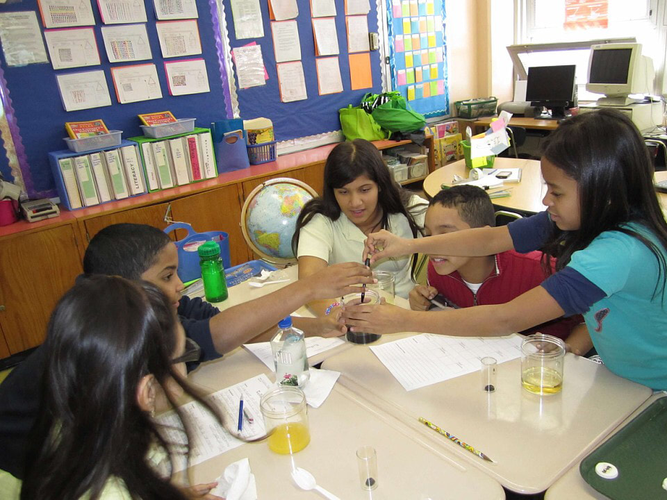 Students engaged in science experiment