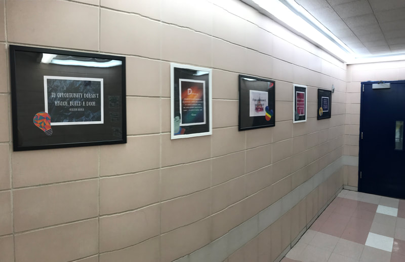 Framed quotes on hallway wall