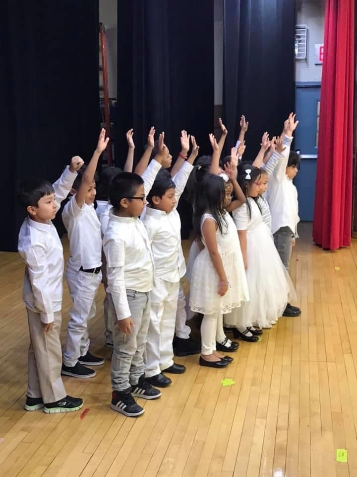 Students in dance raising their hands