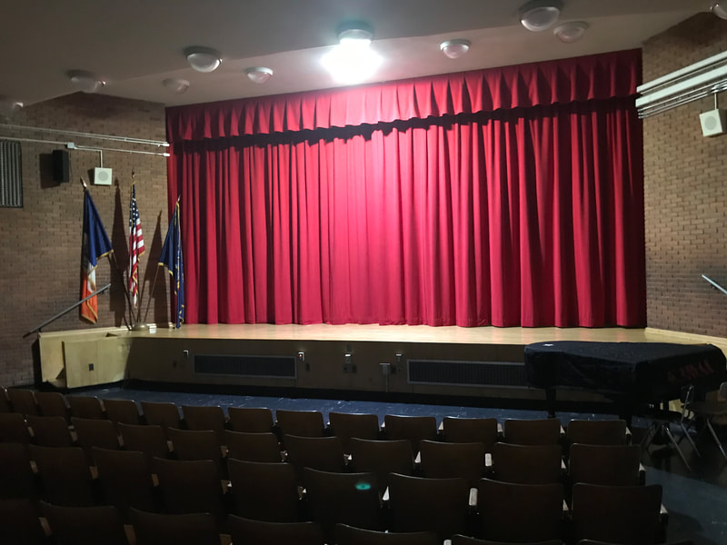 School theatre with red curtain