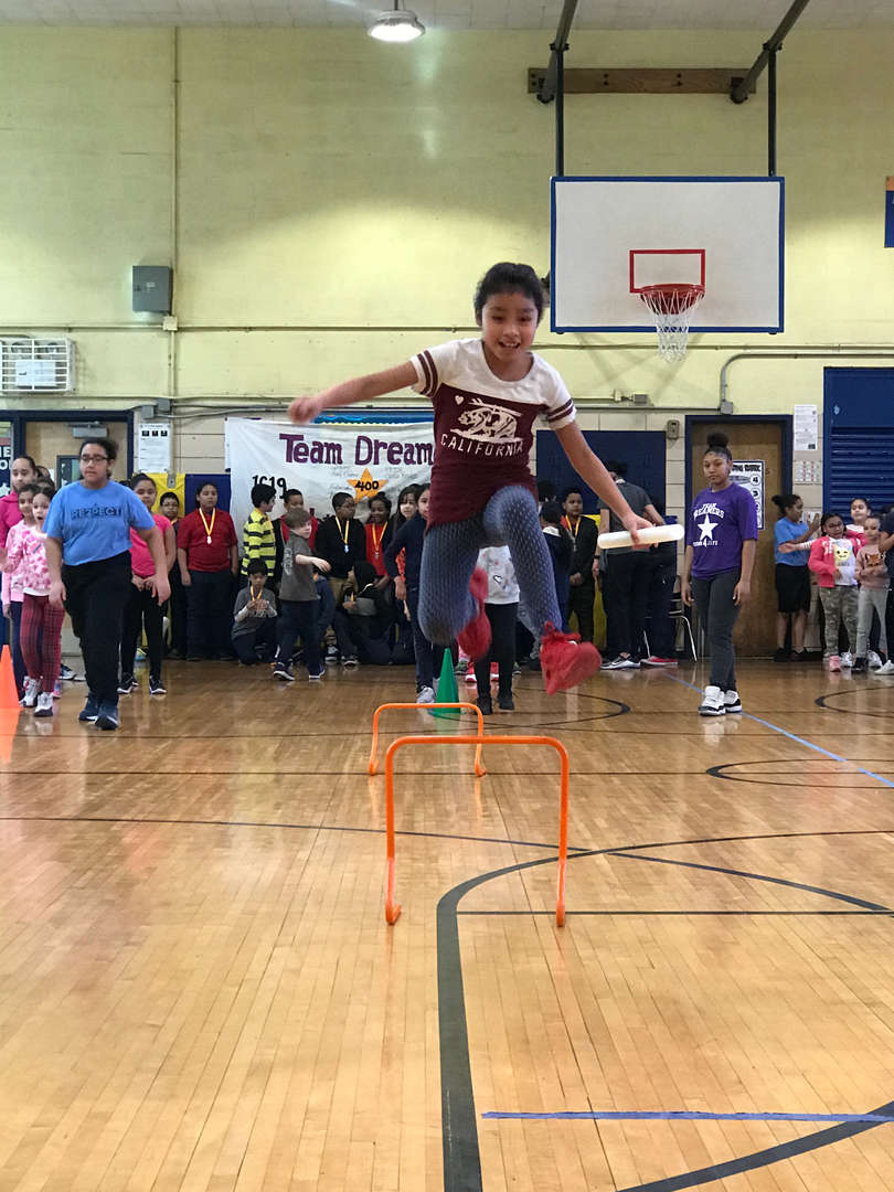 Student in gym completing obstacle course