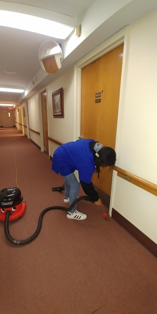 Student helping to clean the Providence facility