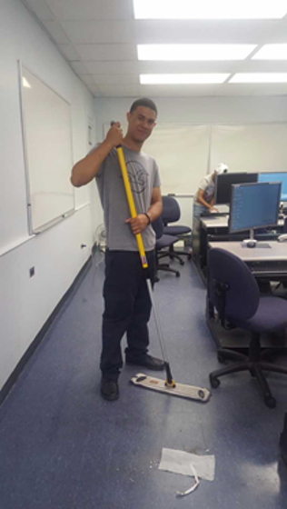 Student mopping at the Montefiore Medical Center