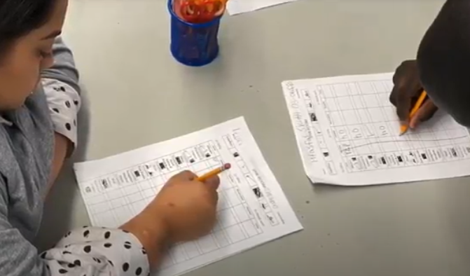 Student pointing to item on a paper