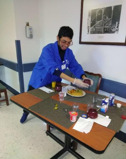 Student plating food