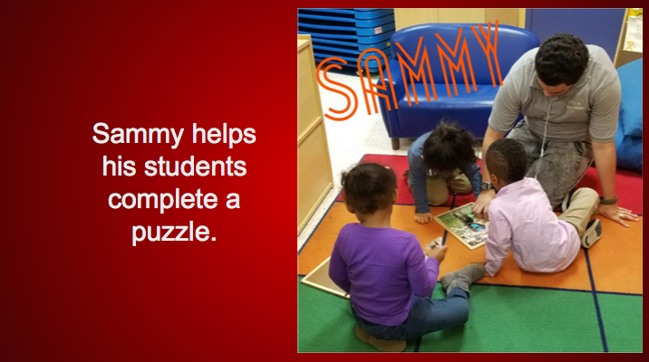 Sammy helps his students complete a puzzle