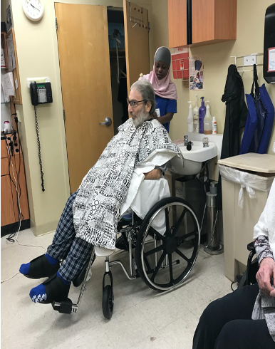 Resident in wheelchair at Providence center