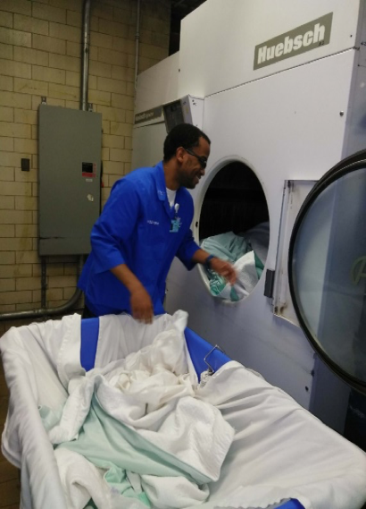 Helping with laundry at Schervier