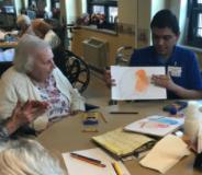 Student showing Providence resident artwork