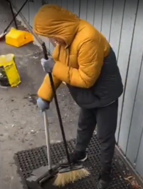 Student sweeping - YMCA Program