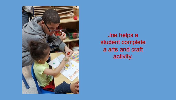 Joe helps a student complete an arts and craft activity