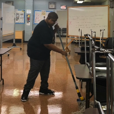 Cleaning the floors of the Glebe center