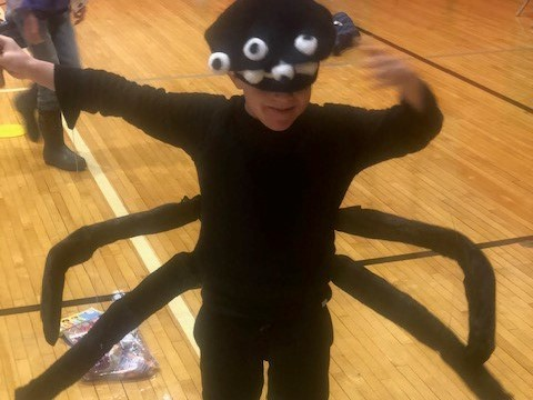 Boy dressed as a spider.