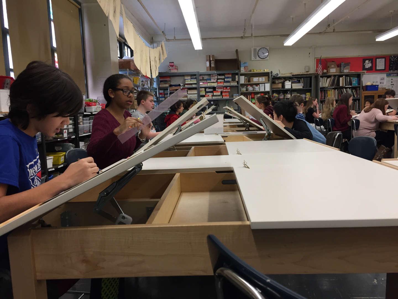 Students work at desks.