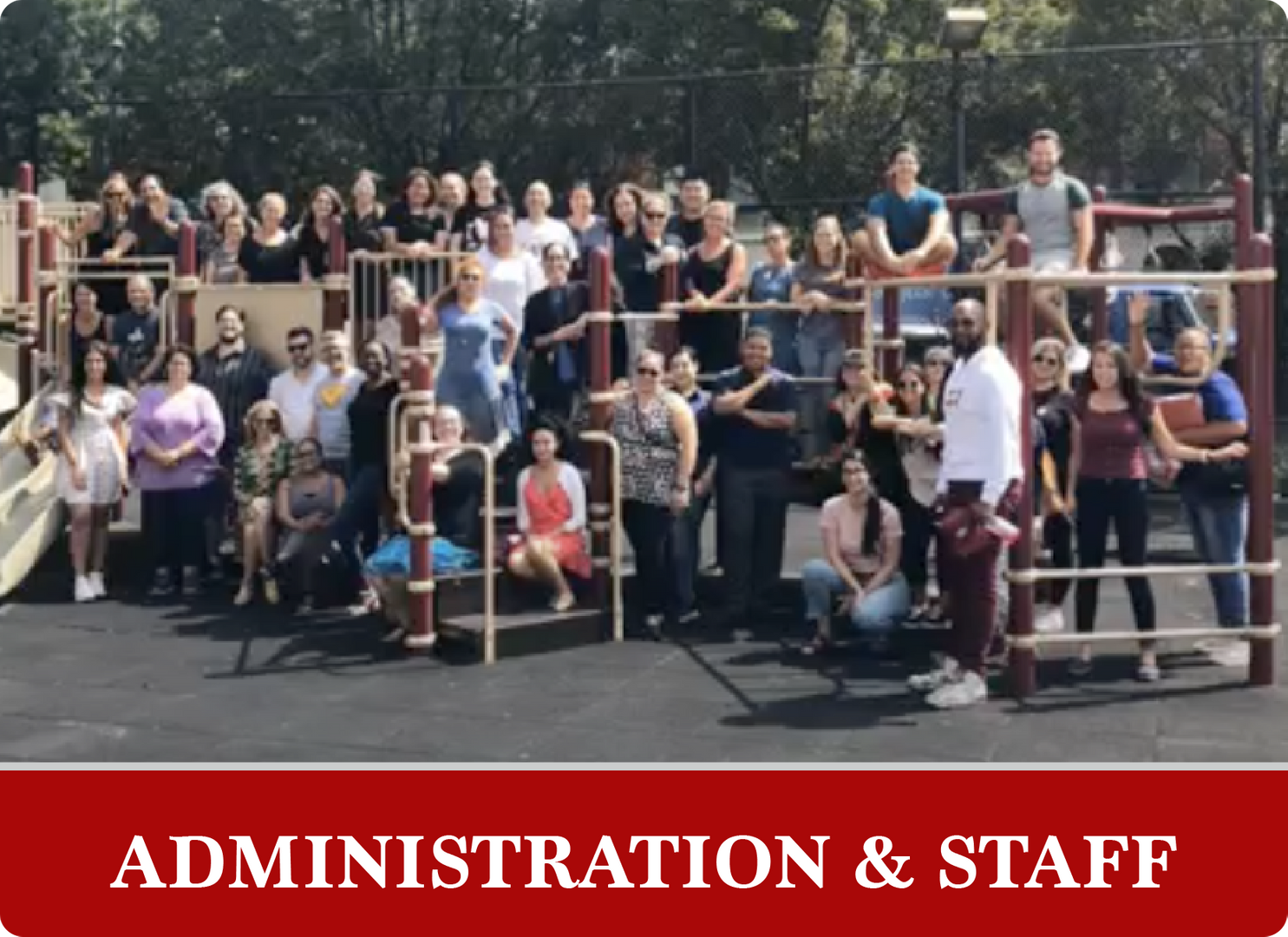 Administration & Staff: group picture of staff standing in a playground