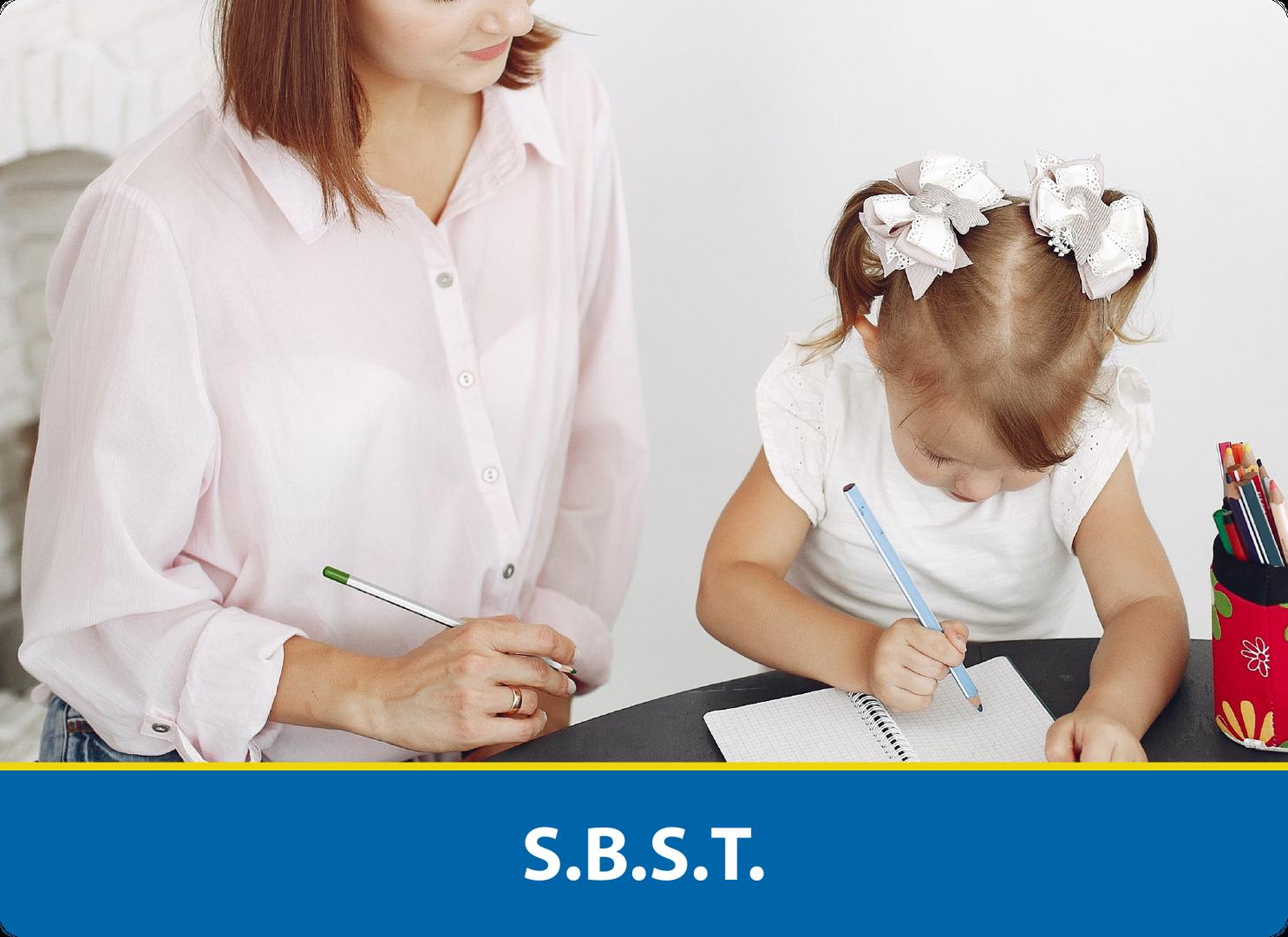 S.B.S.T.: Teacher looking over student working