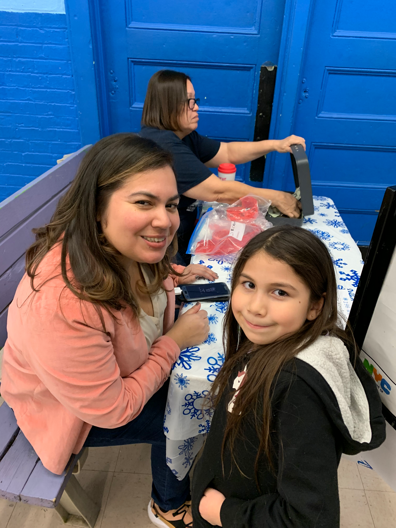 Family helping at PTA Winter Wonderland 2019 Event