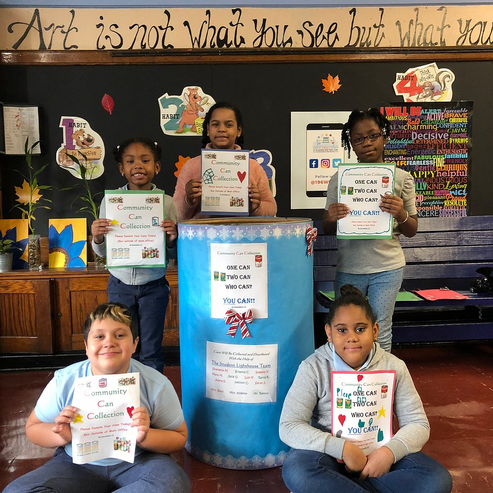 Students holding community can collection flyers