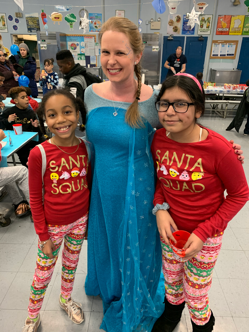 Girls pose with Frozen's Elsa at PTA Winter Wonderland 2019 Event