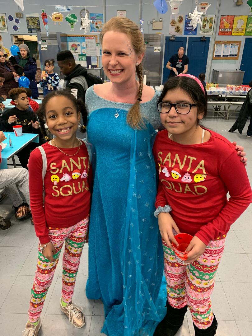 Girls pose with Frozen's Elsa at PTA Winter Wonderland 2019 Event