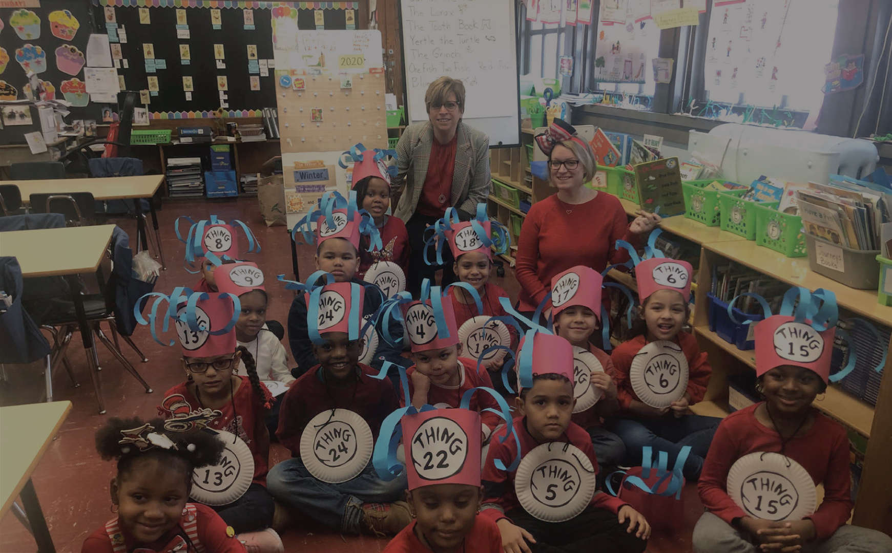"Principal Colon, a teacher, and students dressed as Dr. Seuss' ""Things"""