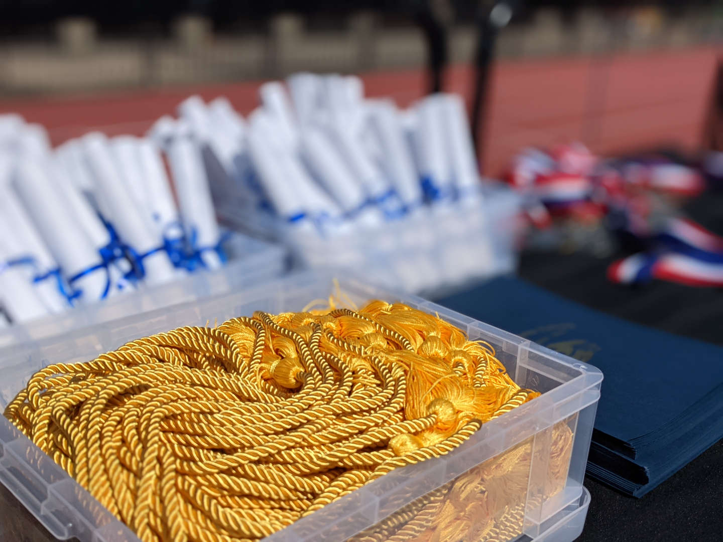 Honor Cords and diplomas ready to be distributed.