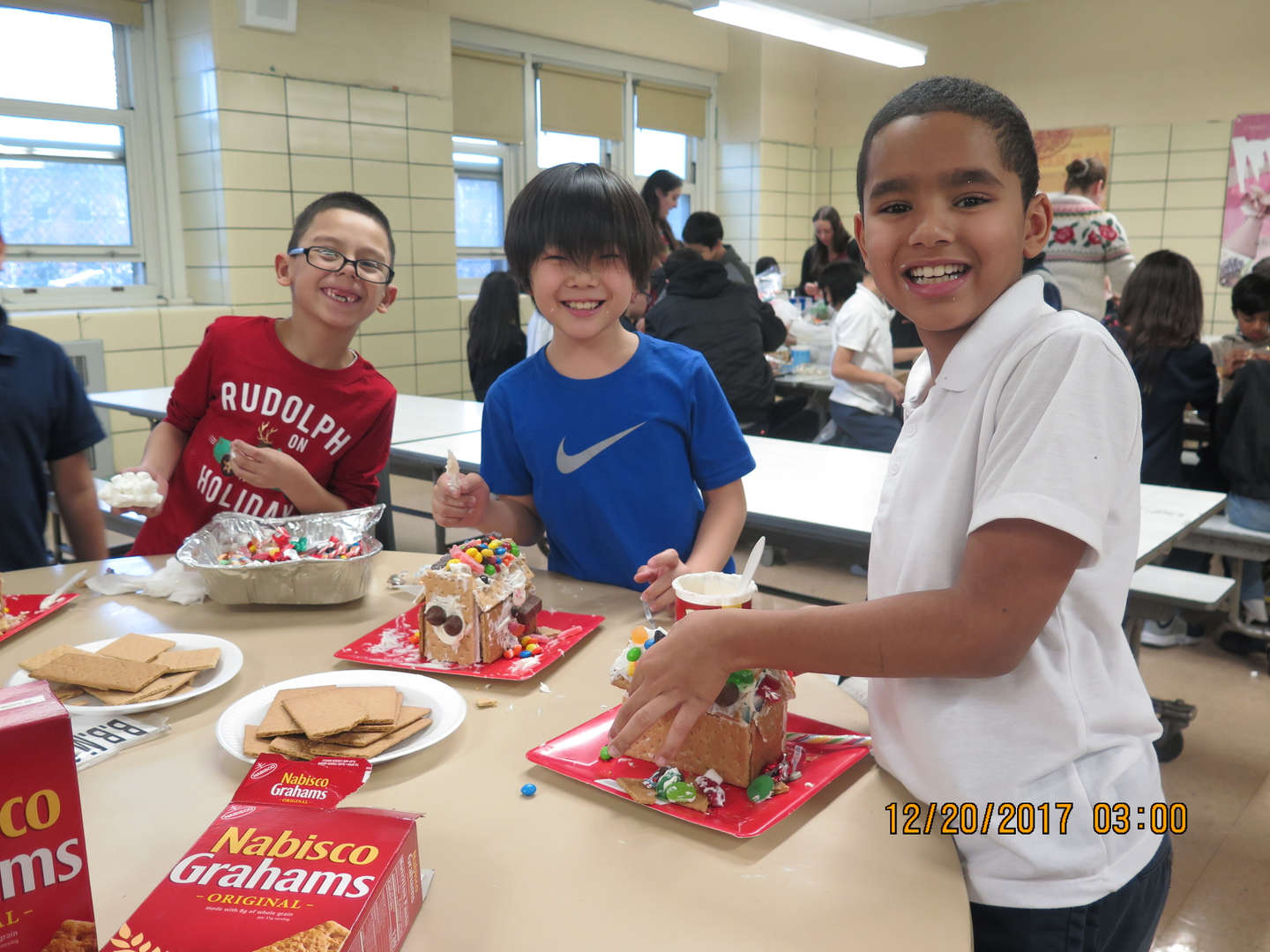 Students building gingerbread houses