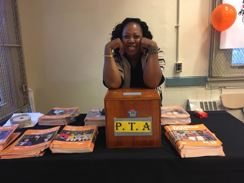 Woman smiling and resting on a P.T.A. box