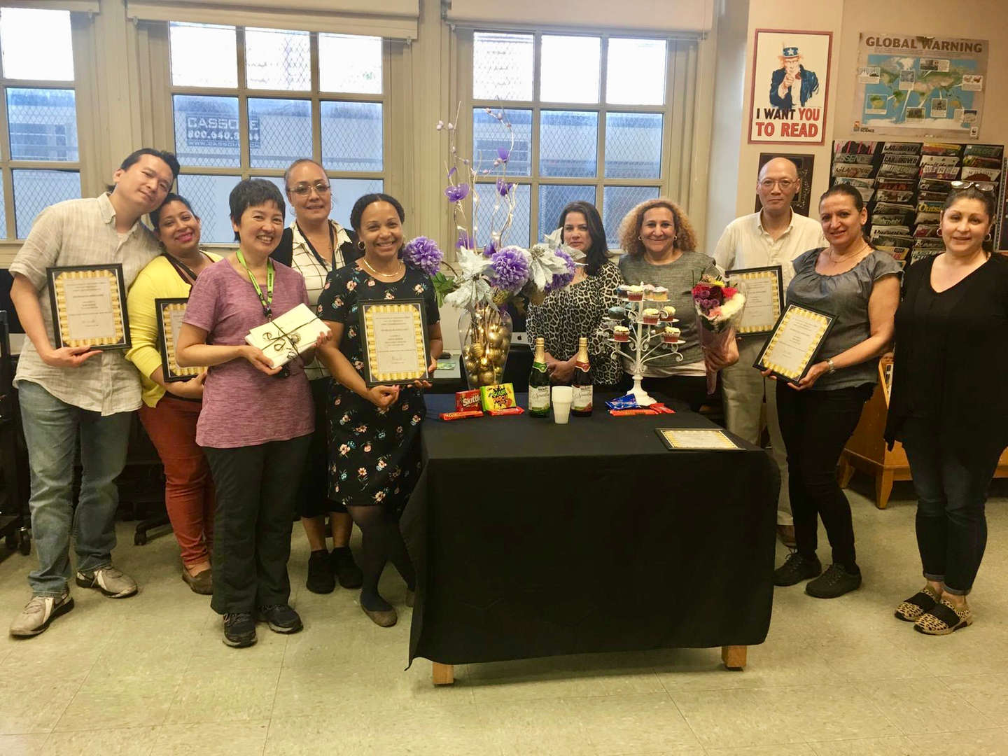 Ten members of the PTA holding award plaques