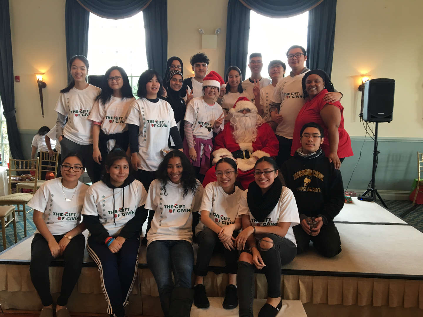 The student government with Santa at the Gift of Giving event