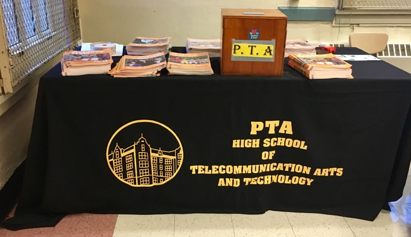 PTA booth table with information booklets
