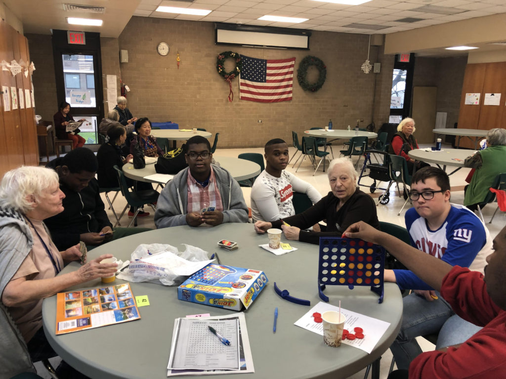Students playing board games with seniors