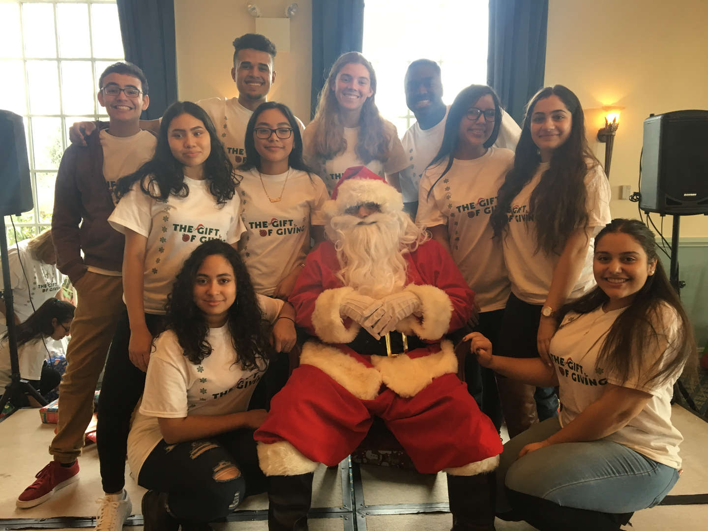 Members of the student government posing with a seated Santa
