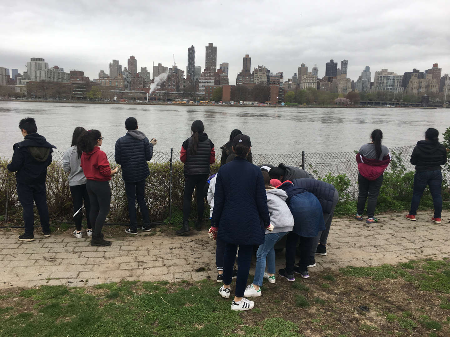 Students look out onto a body of water