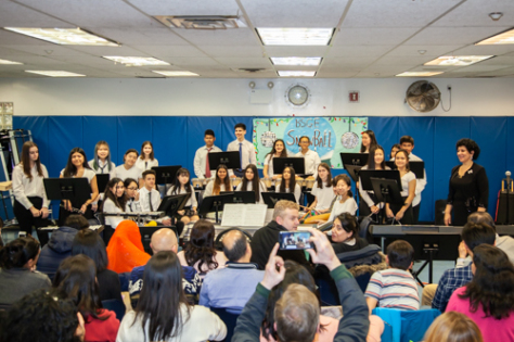 Parents photograph the student musicians