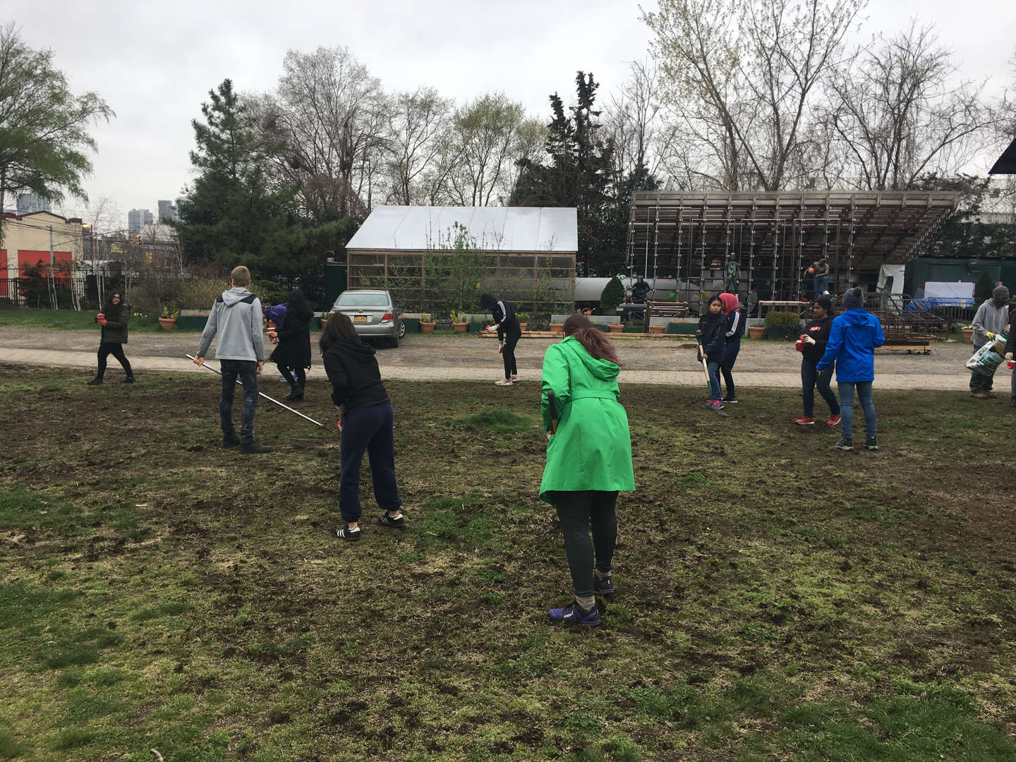 Students are bent, seeding the lawn