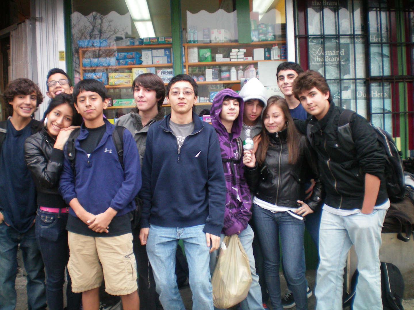 A group of students in front of a store