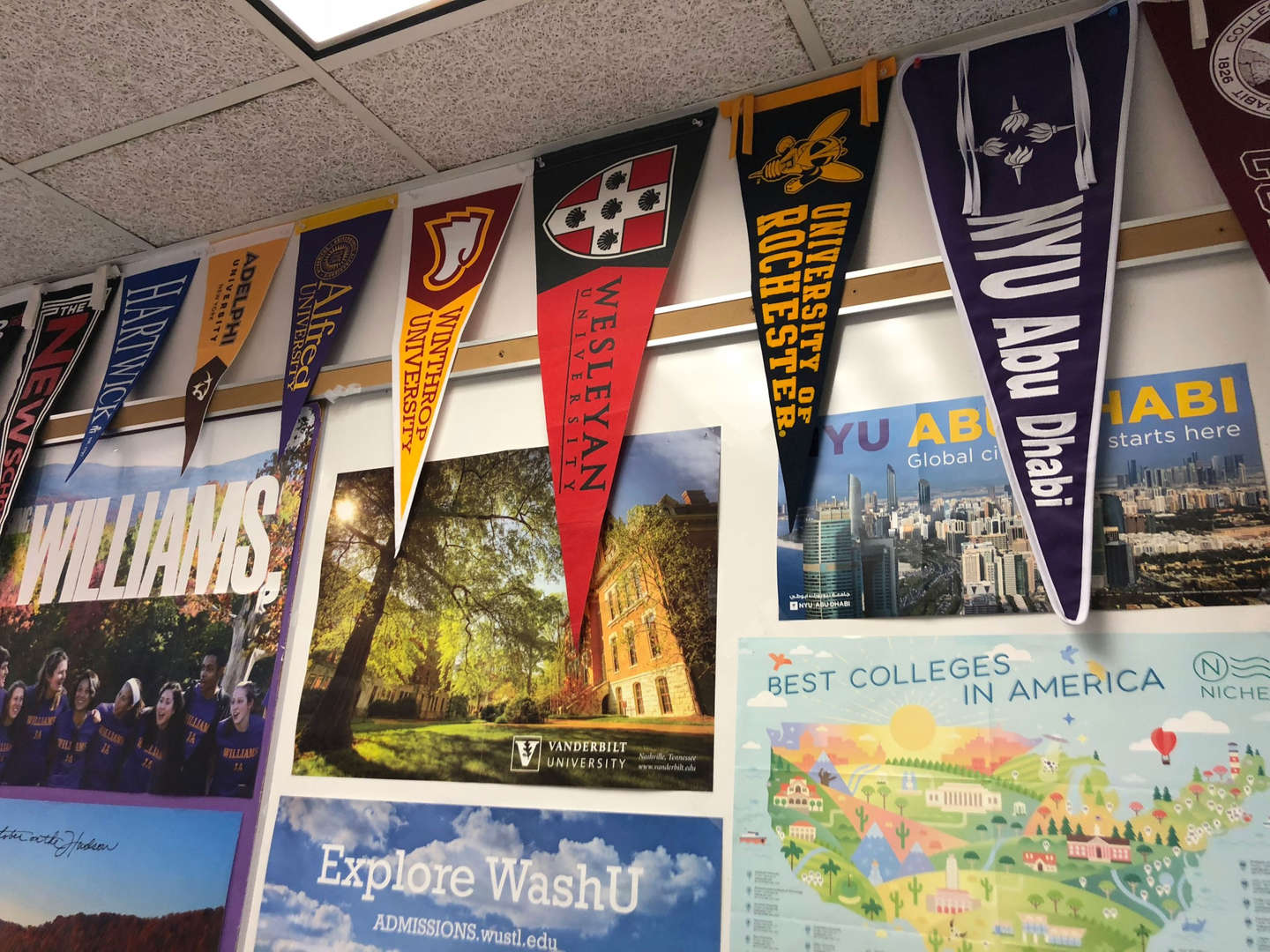 College pennants and posters on a wall