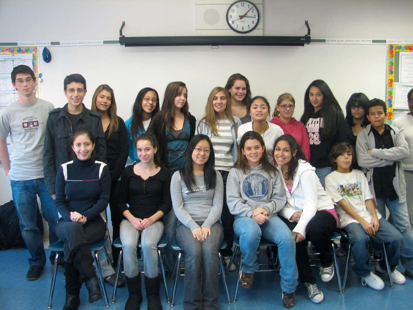A group of students posing at the front of a classroom