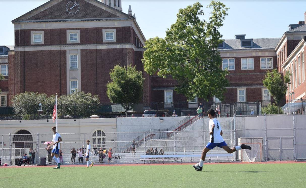 A BSGE soccer player sprinting across the soccer field
