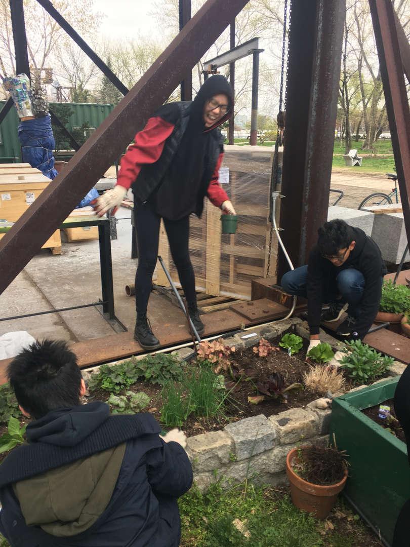 Students examine their planting and garden bed