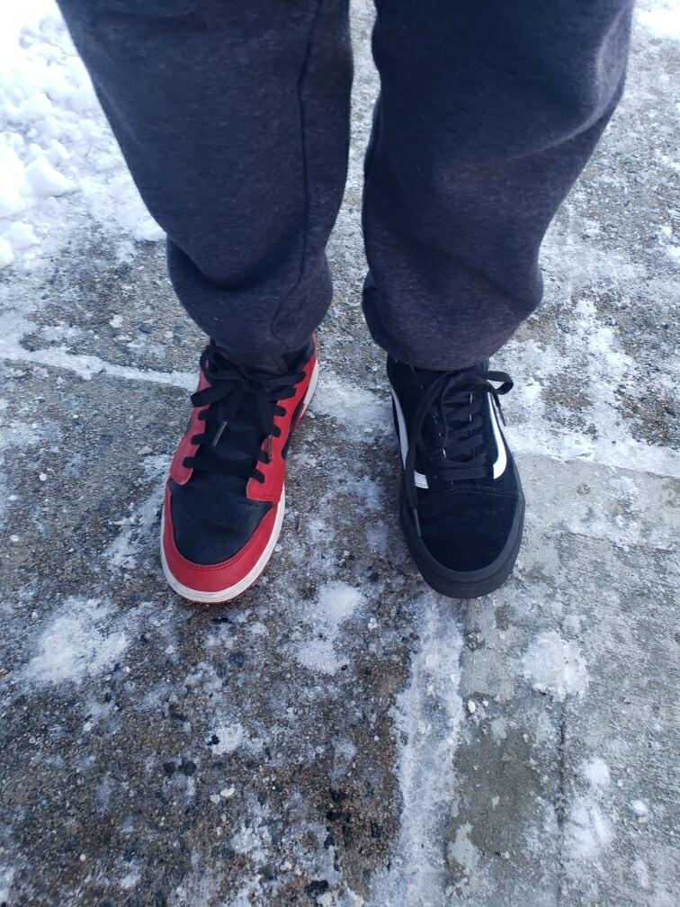 Student wearing mixed matched shoes to celebrate differences.