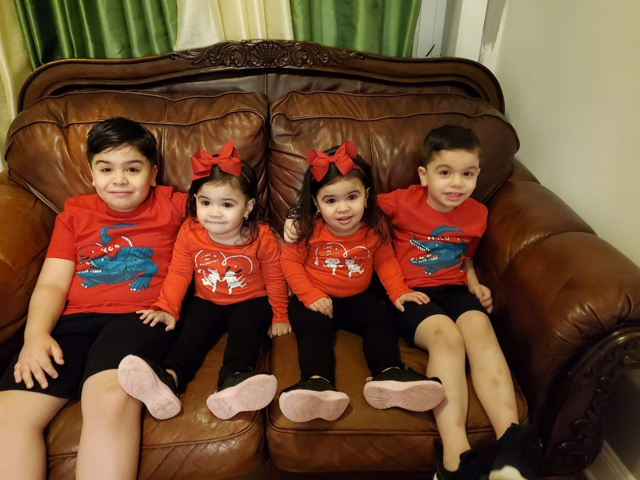 Twins and brothers wearing red.