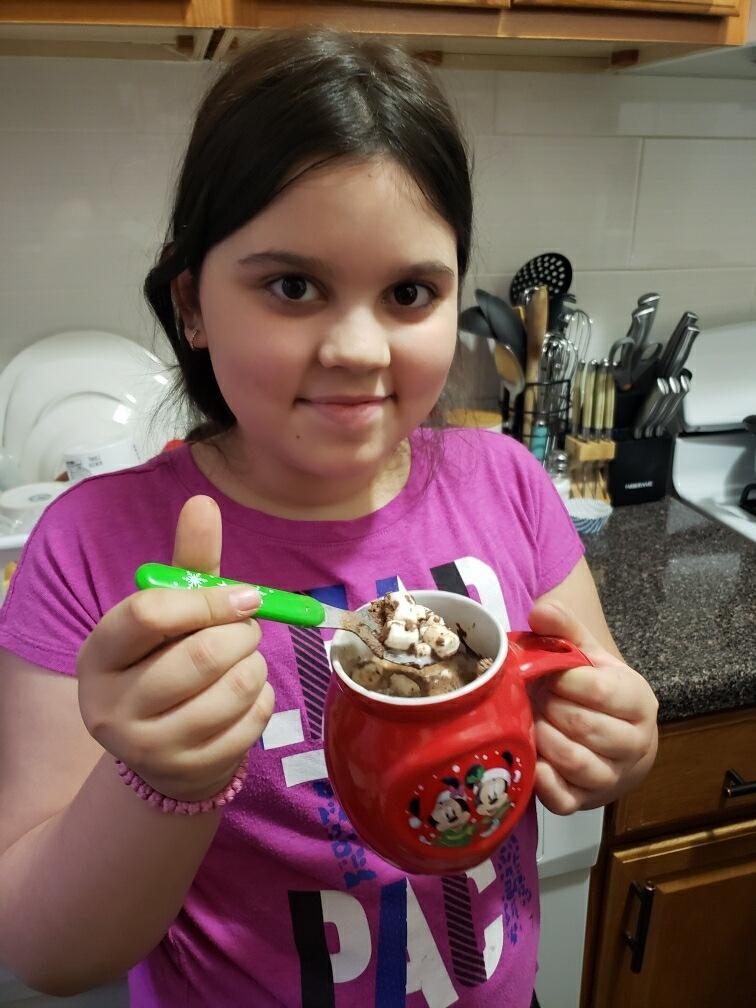 Elena drinking her hot cocoa.